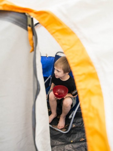 Luke took a break to enjoy a bit of a snack, but was riveted to the game going on outside the tent.